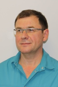 хирург имплантолог Ошаров  фото